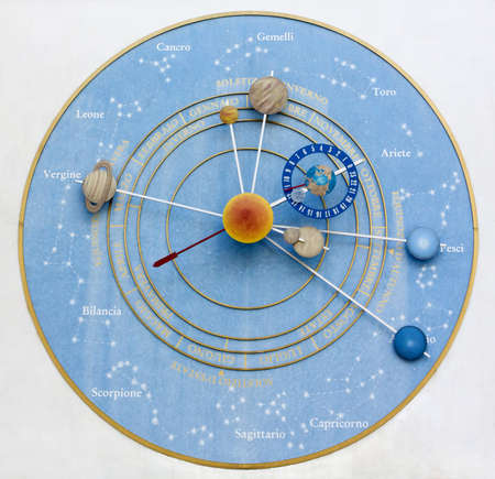 The Clock of the Planets in Pesariis, Italy photo