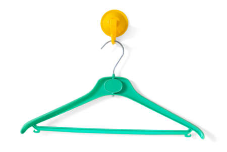 clotheshanger: Green Clotheshanger Hanged On A Yellow One
