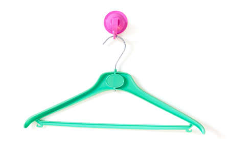 Green Clotheshanger Hanged On A Purple One