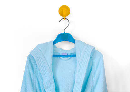 toweling: Clotheshanger With a Blue Bathrobe