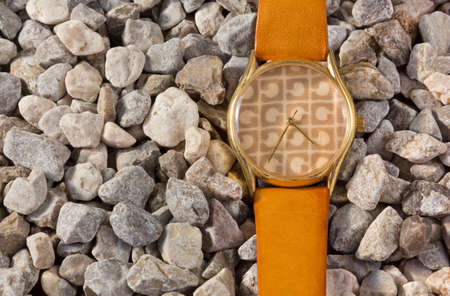 Womens Watch on the Gravel Stock Photo