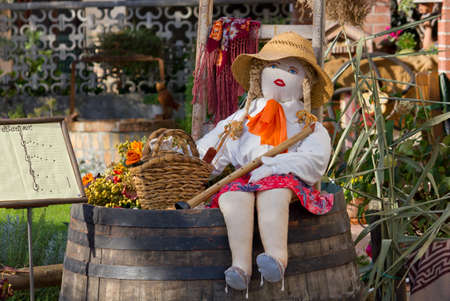 rag doll: Country girl rag doll sitting over a barrel with a flute in her hand