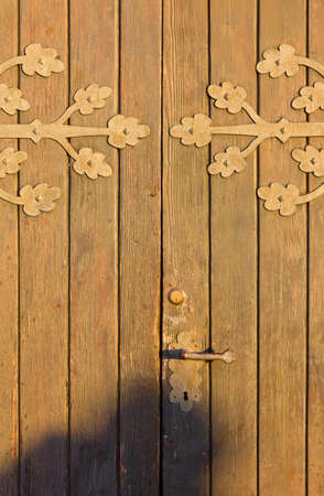 country church: Old wooden country church door at sunset