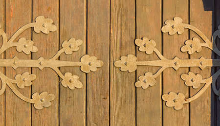 country church: Detail of an old wooden country church door at sunset Stock Photo