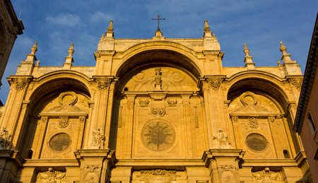 Facade of the Renaissance Cathedral of Granada, Spain, at sunset