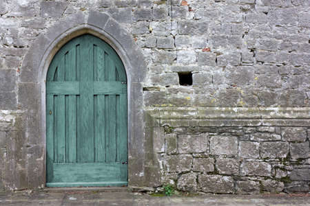 lock block: Old turquoise gothic church back door