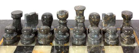 chessmen: Black marble chessmen on a chessboard