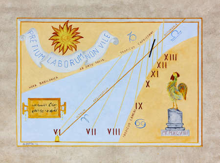 equinox: AIELLO DEL FRIULI, Italy - September 2013: Artistic sundial, with latin text and roman numerals, painted on an exterior wall in the town of Aiello, in the Friuli plain.
