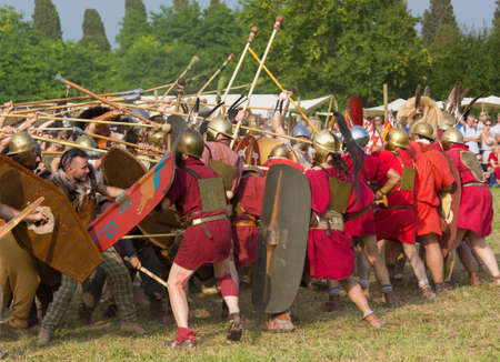 celts: AQUILEIA, Italy - June 22, 2014: Battle between the Romans and the Carnic Celts at the ancient roman reenactment Editorial