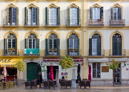 merced: MALAGA, Spain - December 25, 2015: Elegant historic buildings facade on Christmas day in Plaza de la Merced