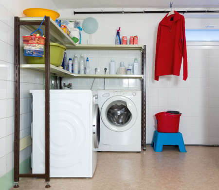 laundry room: Home laundry room with two washing machines Stock Photo