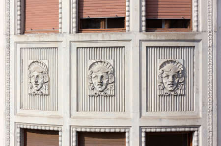 Art Nouveau marble sculptures of a face on a building's exterior in Trieste, Italy Stock fotó