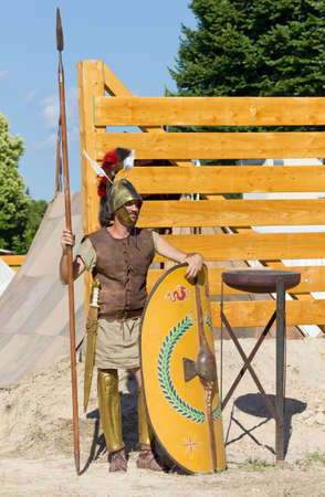 reenactment: AQUILEIA, Italy - June 18, 2017 : Soldier guarding the entrance of an ancient roman military encampment at the local historical reenactment