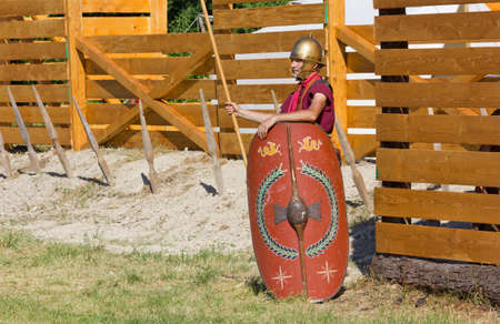 legion: AQUILEIA, Italy - June 18, 2017 : Ancient Roman soldier guarding the entrance of a military encampment at the local historical reenactment Editorial
