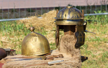Ancient Roman helmets and daggers at a historical reenactment Stock Photo