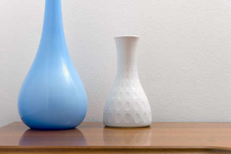 Two Elegant Blue And White Ceramic Vases On A Wooden Chest Stock
