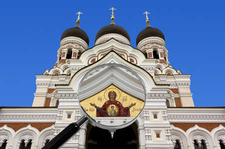 Alexander Nevsky Orthodox cathedral in Tallinn, Estonia, under the magnifying glass highlighting the beautiful mosaic on the facade Stock Photo