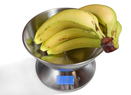Modern electronic metal kitchen weighing scales with bananas Stock Photo