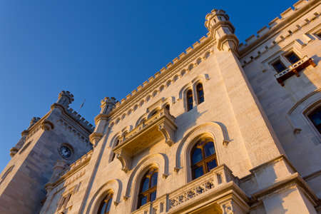 Facade of Miramare castle in Trieste, Italy, at sunset Editorial