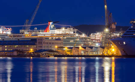 MONFALCONE, Italy - March 27, 2018: Monfalcone shipyards with the Carnival Horizon giant cruise ship the evening before its delivery, together with another ship under construction