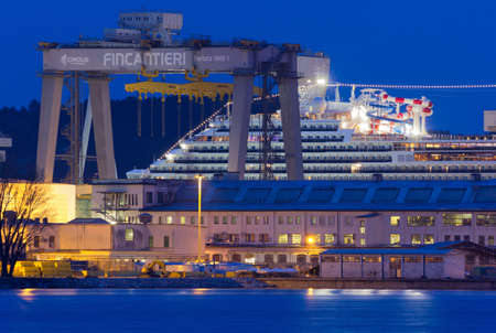 MONFALCONE, Italy - March 27, 2018: Carnival Horizon giant cruise ship in the Monfalcone shipyard the evening before its delivery