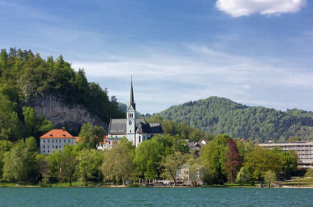 Bled, Slovenia, with its lake and Saint Martin neogothic church during springtime