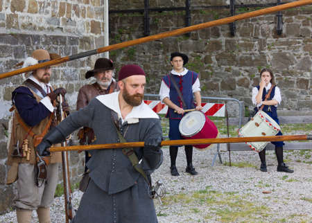 GORIZIA, Italy - May 6, 2018: Soldiers of the Seventeenth century Venetian army at the historical reenactment held at the castle, with a couple of drummers in the background