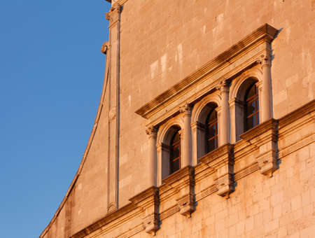 Warm sunset light on a detail of the facade of the Duomo of Cividale del Friuli, Italy Reklamní fotografie - 123097387