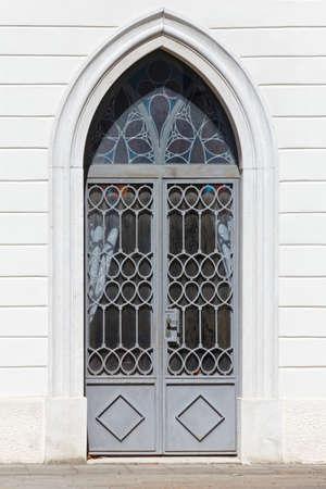 Arched exterior door on the facade of a historic building Reklamní fotografie - 123097388