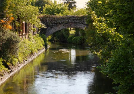 Ancient stone bridge crossing a canal in Aquileia, Italy Reklamní fotografie