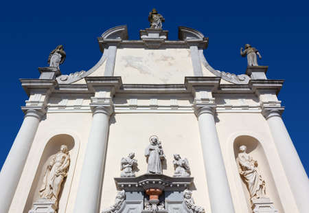 Facade of the small baroque Saint Anthony church in Aquileia, Italy Reklamní fotografie - 123097411