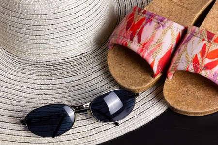 White straw hat, beach sandals and a pair of blue shaded sunglasses Reklamní fotografie - 123097440