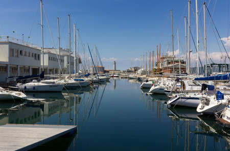 TRIESTE, Italy - May 25, 2019: View of the Sacchetta marina, with the former Lanterna lighthouse in the background