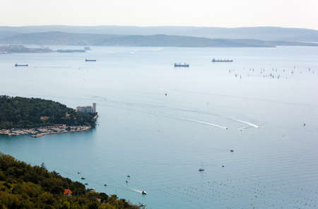 Crowded waters in the gulf of Trieste, Italy, with the Miramare castle in the foreground
