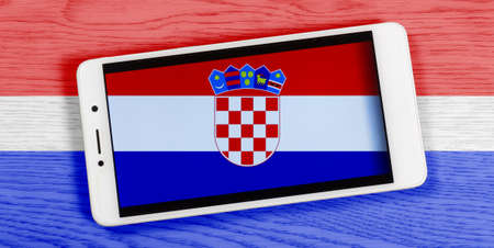 Flag of Croatia composed by placing a smartphone displaying its symbol on a colored wooden background