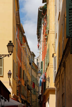 Colorful historic buildings on a street in downtown Nice, France