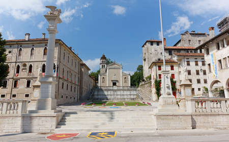 Piazza Maggiore, the main square of the historic district of Feltre, Italy, with San Rocco church in the background Editoriali