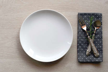 upperdeck view: shabby chic table setting with wooden background and vintage cutlery. top view Stock Photo