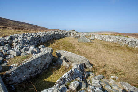irish history: Cloughanmore court tomb in Glencolmcille in Co. Donegal, Ireland Stock Photo