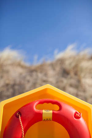sand dunes: Abstract of life bouy and sand dunes