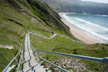 The steps down to the Silver Strand beach in Donegal, Ireland photo