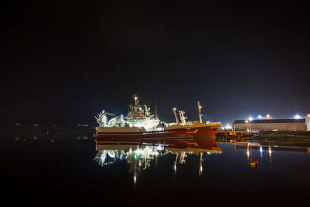 fishing rig: Fishing trawlers docked at Killybegs harbor at night time Stock Photo