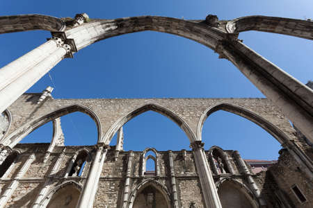 nave: The central nave of the Convento do Carmo in Lisbon. This large cathedral built by the Carmelite order and was destroyed during the Lisbon earthquake of 1755 leaving only the bare arches and walls. Stock Photo