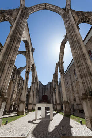 carmo: The central nave of the Convento do Carmo in Lisbon. This large cathedral built by the Carmelite order and was destroyed during the Lisbon earthquake of 1755 leaving only the bare arches and walls. Stock Photo