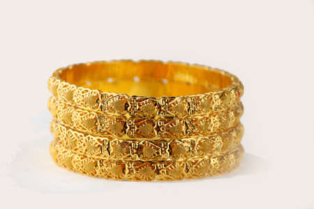 Gold Bangles stacked white background