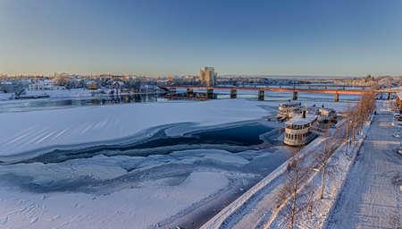 frozen river: Frozen River with Brigde in Umea, Sweden Stock Photo