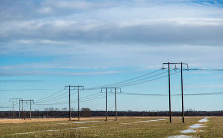 thawing: Electricity Pylons in Thawing Field