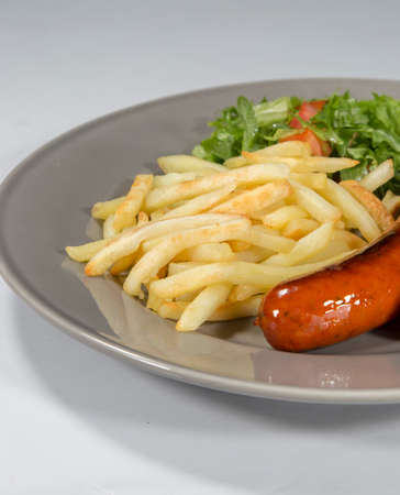 fryed: Sausage and French Fries Stock Photo