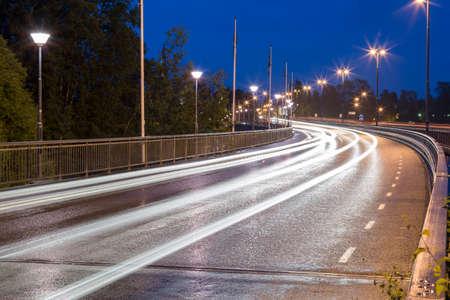 street signs: Light Trails on Bridge in Umea, Sweden Stock Photo