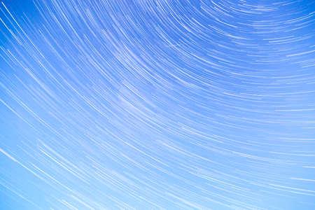 streaking: Star Trails streaking across a Blue Sky Stock Photo